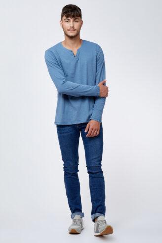 ג'ינס כחול שטוף כיסים מעוצבים